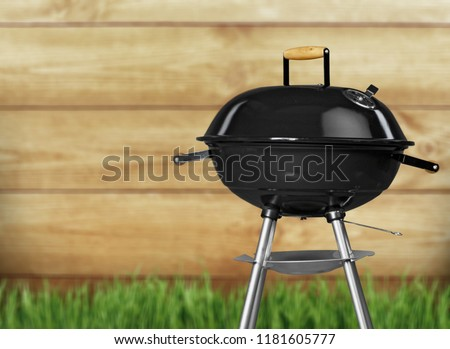 Kettle barbecue grill with cover isolated on