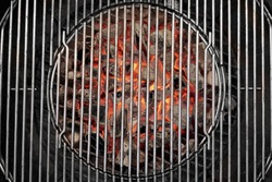 Kettle Grill Pit With Flaming Charcoal. Top View Of BBQ Hot Kettle Grill With Stainless Steel Grid, Isolated Background, Overhead View. Barbecue Kettle Grill On Backyard Ready Grilling Cookout Food.