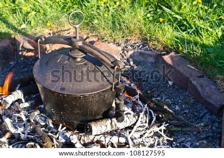 Kettle on fire in the garden