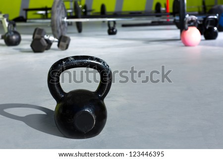 Kettlebell at gym with lifting bars in background