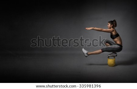 kettlebell balance demonstration, dark background