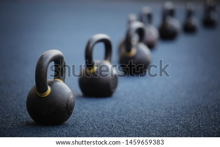 Kettlebells in gym.Professional crossfit and body building equipment in sport club.Train your muscles with heavy weight kettlebell.Set of specialized weights for strength training program