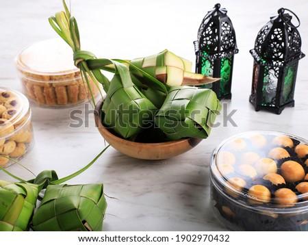 Ketupat and Ied al Fitr Cake (Kue Lebaran) Food Festive for Family in Indonesian or Malayasia Moslem Culture