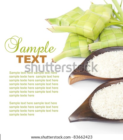 Ketupat and rice on white background. Ketupat is traditional food in Malaysia for Eid Al Mubarak