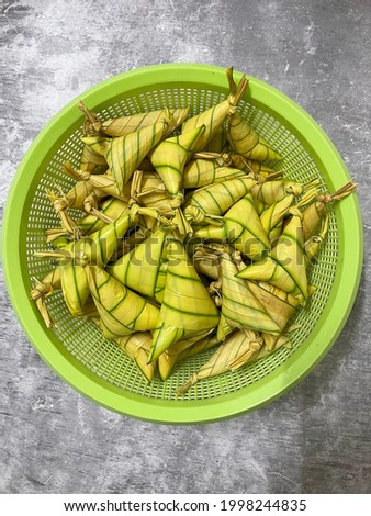Ketupat daun palas in Malay is a rice cake packed inside of palas leaf. It's made from glutinous rice and coconut milk. This meal famous during eid celebration in Malaysia. Foto stock ©