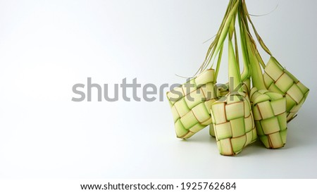 Ketupat or rice dumpling is a local delicacy during the festive season. Ketupats, a natural rice casing made from young coconut leaves for cooking rice isolated on a white background