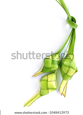Ketupat (Rice Dumpling) On White Background. Ketupat is a natural rice casing made from young coconut leaves for cooking rice during eid Mubarak, Eid ul Fitr #1048413973