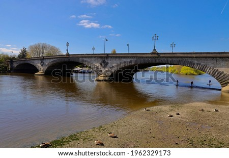 Kew Bridge is a Grade II listed bridge over the River Thames in the London Borough of Richmond upon Thames and the London Borough of Hounslow.
