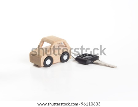 Key and Car wooden on white background.