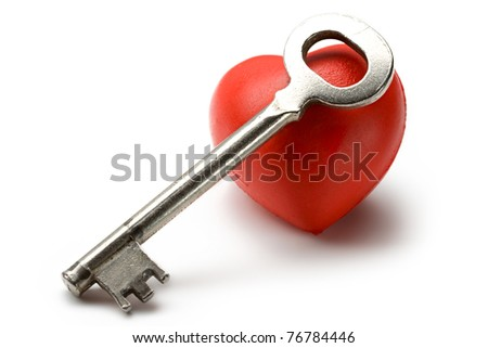 Key and heart on the white background