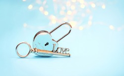 key and Heart padlock on blue background. February 14, Valentine's day concept. symbol of love, true feelings, wedding, reliability of relationship