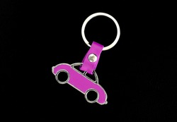 Key chain pink car on black background