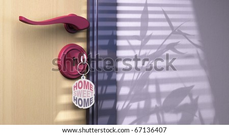 key chain with home sweet home written on it. the key is inserted into a lock, the handle is visible and there is copyspace on the left side of the picture