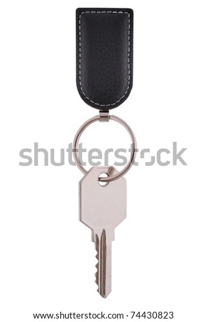 Key hangs on black keyring. Isolated on white, clipping path included.