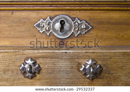 Key hole over old wood.