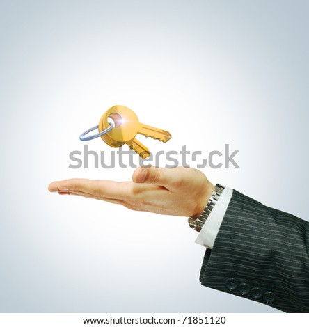 Key in businessman's hand
