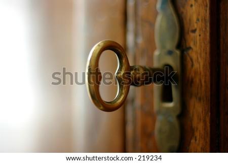 key in door lock - stock photo