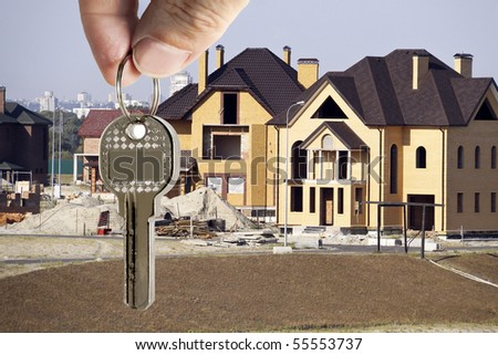 key in fingers on a background cottages