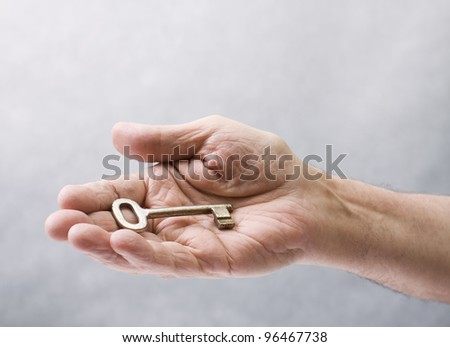 Key in hand - stock photo