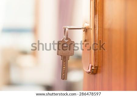 Key in keyhole on door