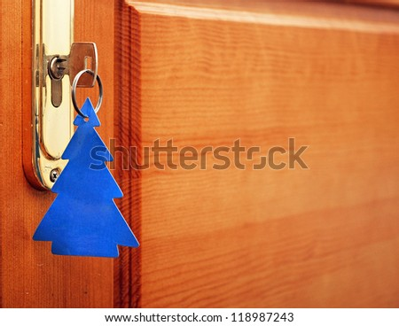 key in keyhole with blank tag in the form of a Christmas tree