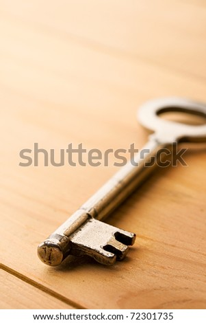 Key isolated on wooden background