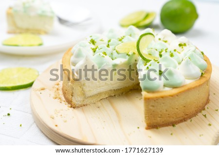 key lime cheese tart with whipping cream on the table