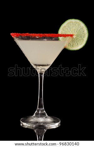 key lime martini with a red sugar rim isolate don a black background - stock photo