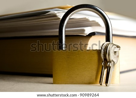 Key lock against the background of paper - stock photo
