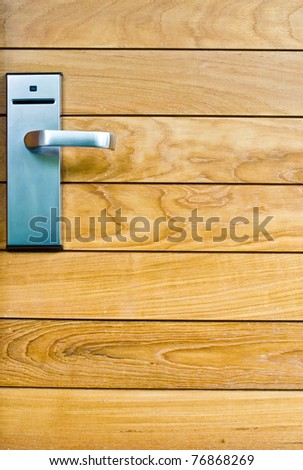 key lock on wood door - stock photo