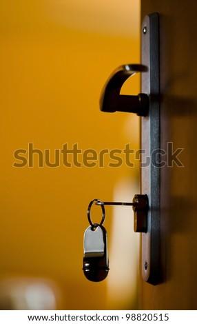 Key of a hotel room in lock.