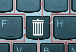 Key on a keyboard with trash can icon. Data deletion concept.