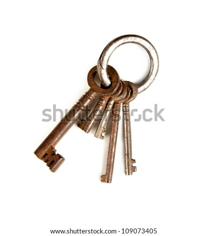 Key-ring isolated on white with rusty keys in different sizes