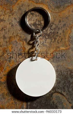 Key ring on the rusty background - stock photo