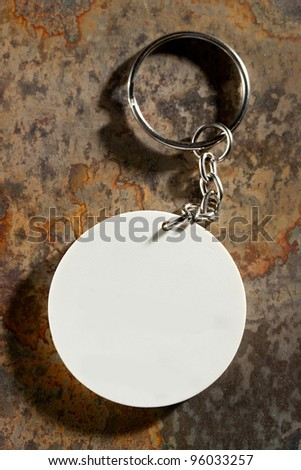 Key ring on the rusty background
