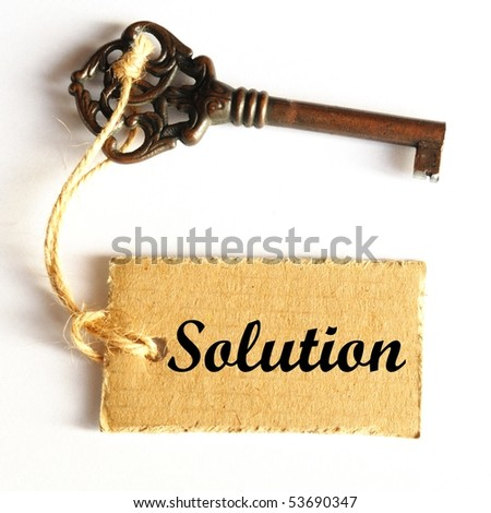 key to solution concept with old grunge label or tag