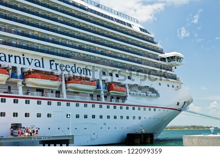 KEY WEST, FL - JULY 11:  Passengers boarding Carnival's Freedom ship after a day in Key West on July 11, 2011. In 1984, the city improved Mallory Dock, making it a full cruise ship docking facility.