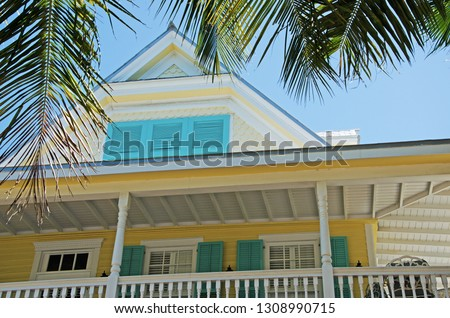 Key West, Florida, Usa: a typical conch house in the old town, historical Key West architecture, a major tourist attraction and an eclectic mix of over 3,000 wooden buildings dating from 1886 to 1912 #1308990715