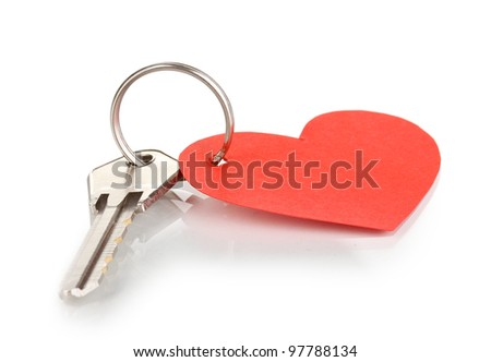Key with heart-shaped charm isolated on white
