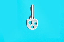 Key with hole as face emotion and blue background