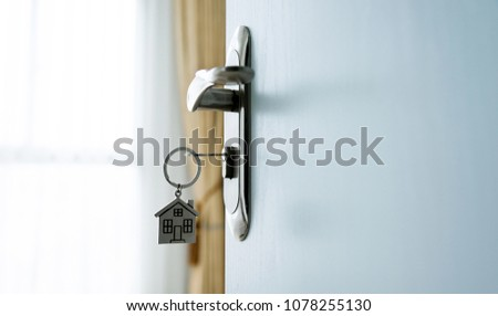 Key with house shaped keyring on door #1078255130
