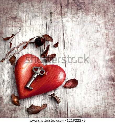 Key with the heart as a symbol of love vintage card with red heart on grunge old background valentin es day background