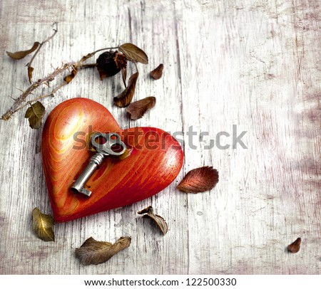 Key with the heart as a symbol of love/vintage card with red heart on grunge old background/valentin es day background