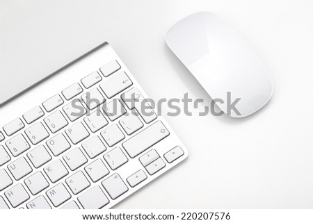Keyboard and mouse on a white background, close-up #220207576