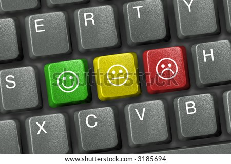 Keyboard close-up with three smiley keys (emoticons) - stock photo