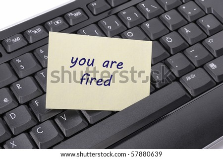 "keyboard in office with message ""you are fired"""