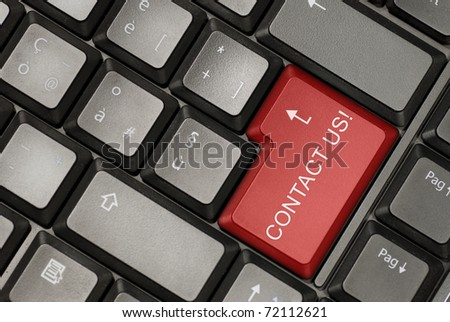 Keyboard of a laptop with contact us button