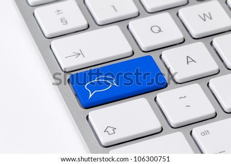 Keyboard with a single blue button showing the chat icon
