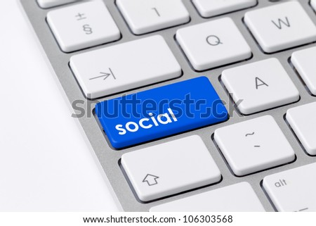 Keyboard with a single blue button showing the word social