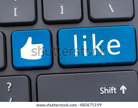 Keyboard with blue like button icon in close up as social media concept
